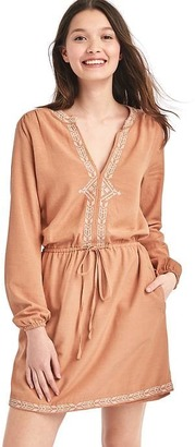Embroidered split-neck dress $79.95 thestylecure.com