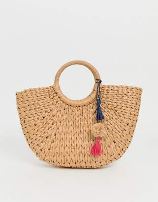 Hat Attack cresent straw basket with pom
