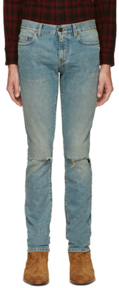 Saint Laurent Blue Original Low Waisted Ripped Skinny Jeans $750 thestylecure.com