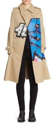 Junya Watanabe Graffiti Cape Trench Coat $3,744 thestylecure.com