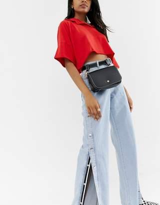 Glamorous black belt bag with contrast stitching