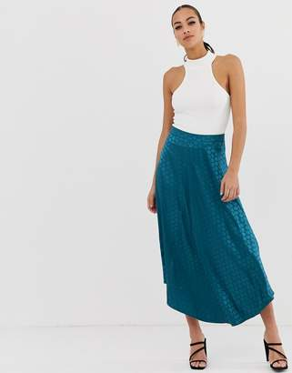 Missguided asymmetric midi skirt in teal polka dot