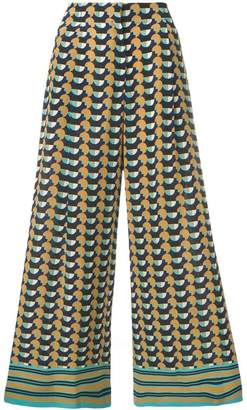 Etro all-over print trousers