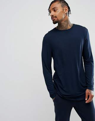 Asos DESIGN longline long sleeve t-shirt in drape viscose fabric in navy