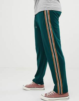 Asos DESIGN retro track tapered joggers with side stripes