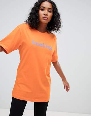 Weekday Organic Cotton statement t-shirt in orange