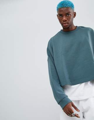 Asos DESIGN oversized cropped sweatshirt in washed green