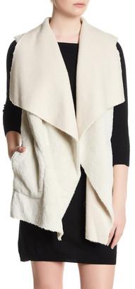 cupcakes and cashmere Novak Draped Faux Fur Vest $155 thestylecure.com