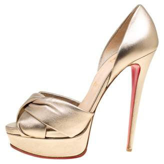 02bea723cd0 Christian Louboutin Gold Leather Heels