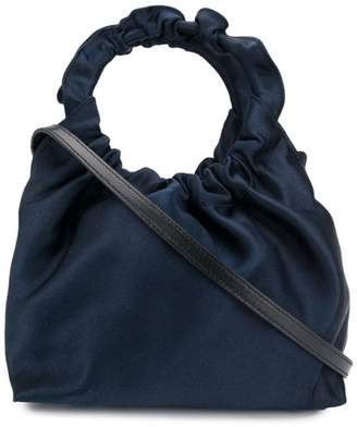 The Row circular top handle bag