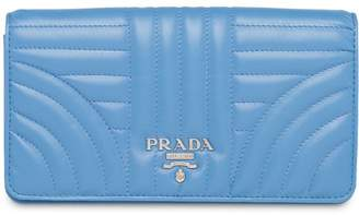 Prada quilted logo clutch