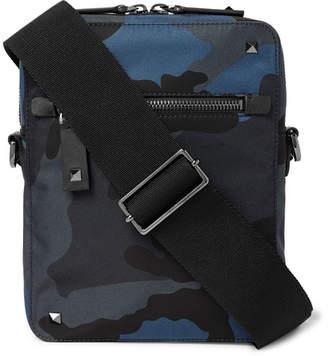 Valentino Garavani Leather-Trimmed Camouflage-Print Canvas Messenger Bag - Men - Navy