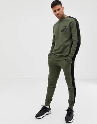 Asos DESIGN tracksuit sweatshirt/skinny joggers with text print and side stripe in khaki