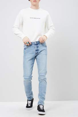 Forever 21 Ripped-Knee Skinny Jeans
