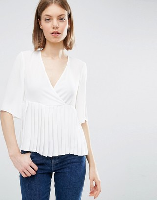 ASOS Wrap Front Pleat Peplum Top $46 thestylecure.com