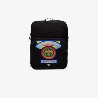 228f60f8883e Gucci black logo badge embellished backpack