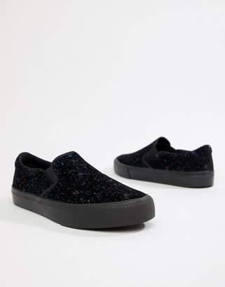 Asos DESIGN slip on plimsolls in black velvet with splatter print