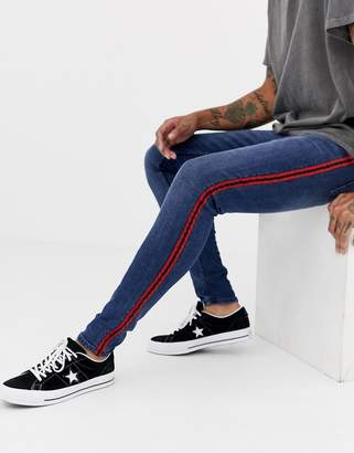 New Look skinny jeans with red side stripe in blue wash