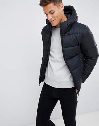 Celio black hooded puffer jacket in dogstooth