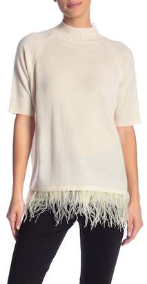 In Cashmere Ostrich Feather Hem Mock Neck Sweater