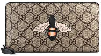 Gucci Bee print GG Supreme zip around wallet