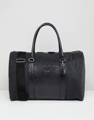 Asos DESIGN carryall in charcoal melton and front pocket