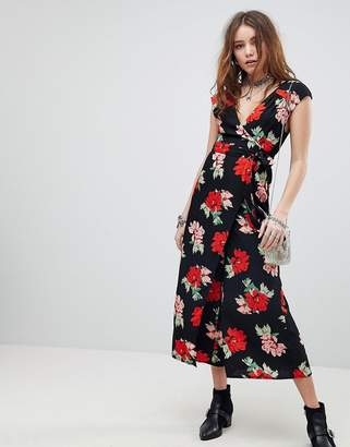 Kiss The Sky Deep V Wrap Front Jumpsuit In Floral Print