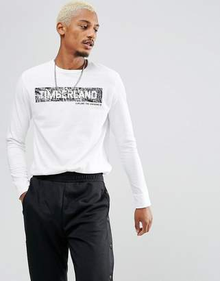 Timberland (ティンバーランド) - Timberland Long Sleeve Top With Reflective Front Logo in White