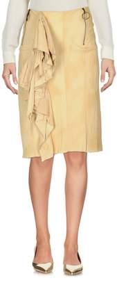 Haute Knee length skirts