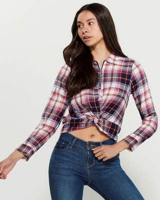 Almost Famous Crave Fame By Flannel Twist Front Zip Shirt