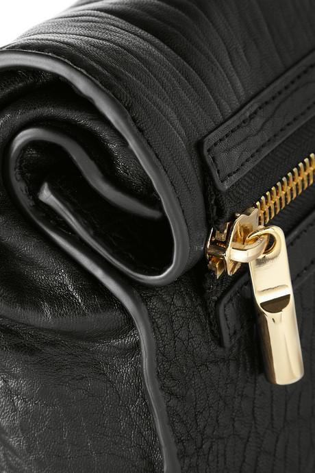 Elizabeth and James Cynnie Roll textured-leather clutch