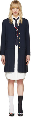 Thom Browne Navy Long Pleated Jacket $2,490 thestylecure.com