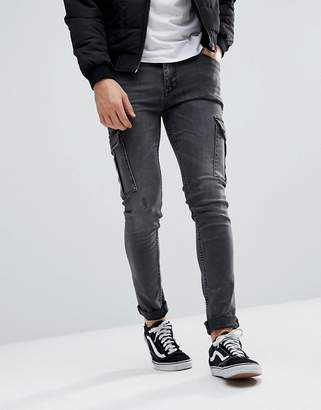 Asos DESIGN super skinny jeans in washed black with cargo pockets
