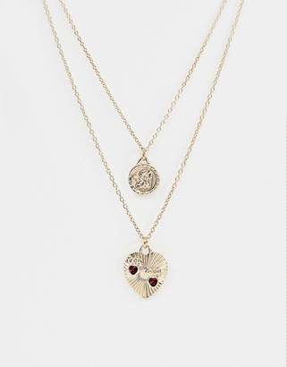 Asos DESIGN multirow necklace with vintage style cupid and engraved heart pendants in gold