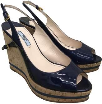 Prada Patent leather mules & clogs