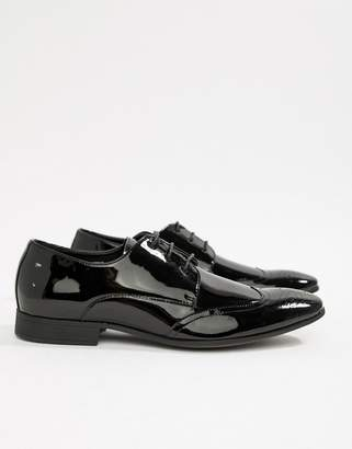 Moss Bros patent brogues in black