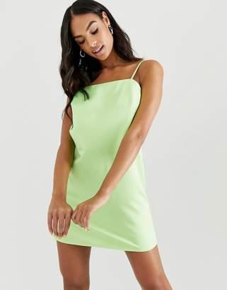 Asos Design DESIGN mini slip dress with strappy back in neon