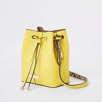 River Island Yellow faux leather duffle cross body bag