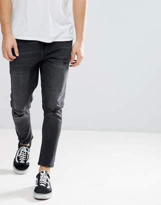 Bershka Skinny Tapered Jeans In Washed Black