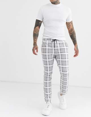 Asos Design DESIGN skinny trousers with elastic waist in wide grey check