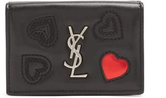 Saint Laurent Heart-embossed leather wallet