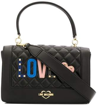 Love Moschino Love quilted appliqué top handle bag