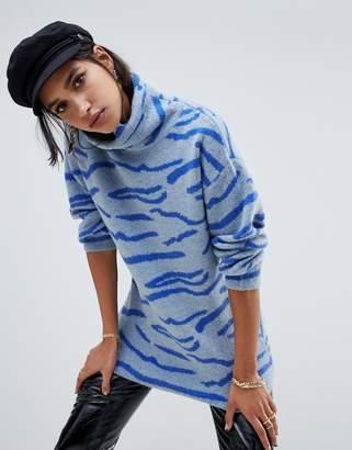 NA-KD turtleneck tiger print sweater in blue