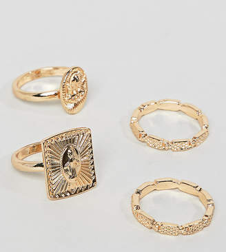 Asos DESIGN Curve pack of 4 rings with vintage style icon design and engraved band in gold