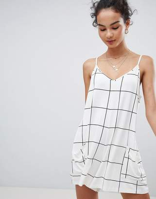 Asos Design DESIGN minimal playsuit with pockets in white check