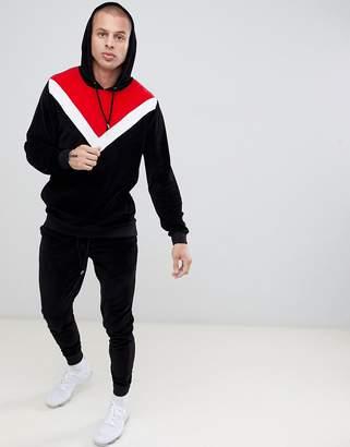 Asos Design DESIGN tracksuit hoodie/ skinny sweatpants in velour with chevron color blocking in black