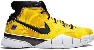 f8579ce38499 Nike x Undefeated Kobe 1 Protro Camo sneakers