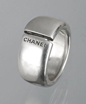 Chanel sterling silver logo slit ring