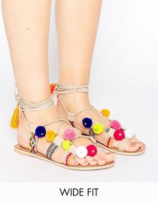 ASOS FRESH Wide Fit Leather Pom Tie Leg Sandals $49 thestylecure.com