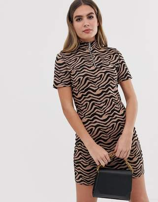 PrettyLittleThing zip front bodycon dress in tiger print